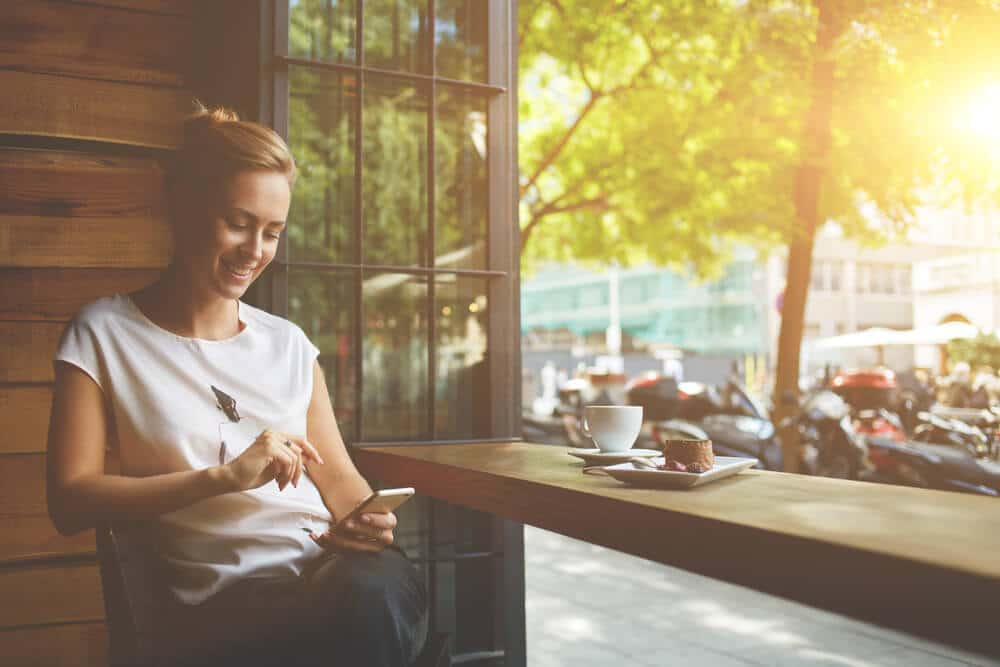 smiling woman using mobile optimised website